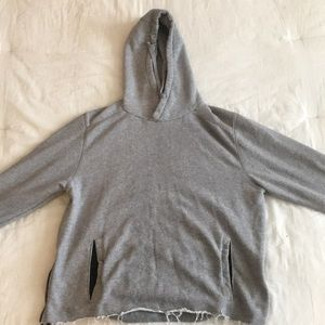gray hoodie with ties and pocket